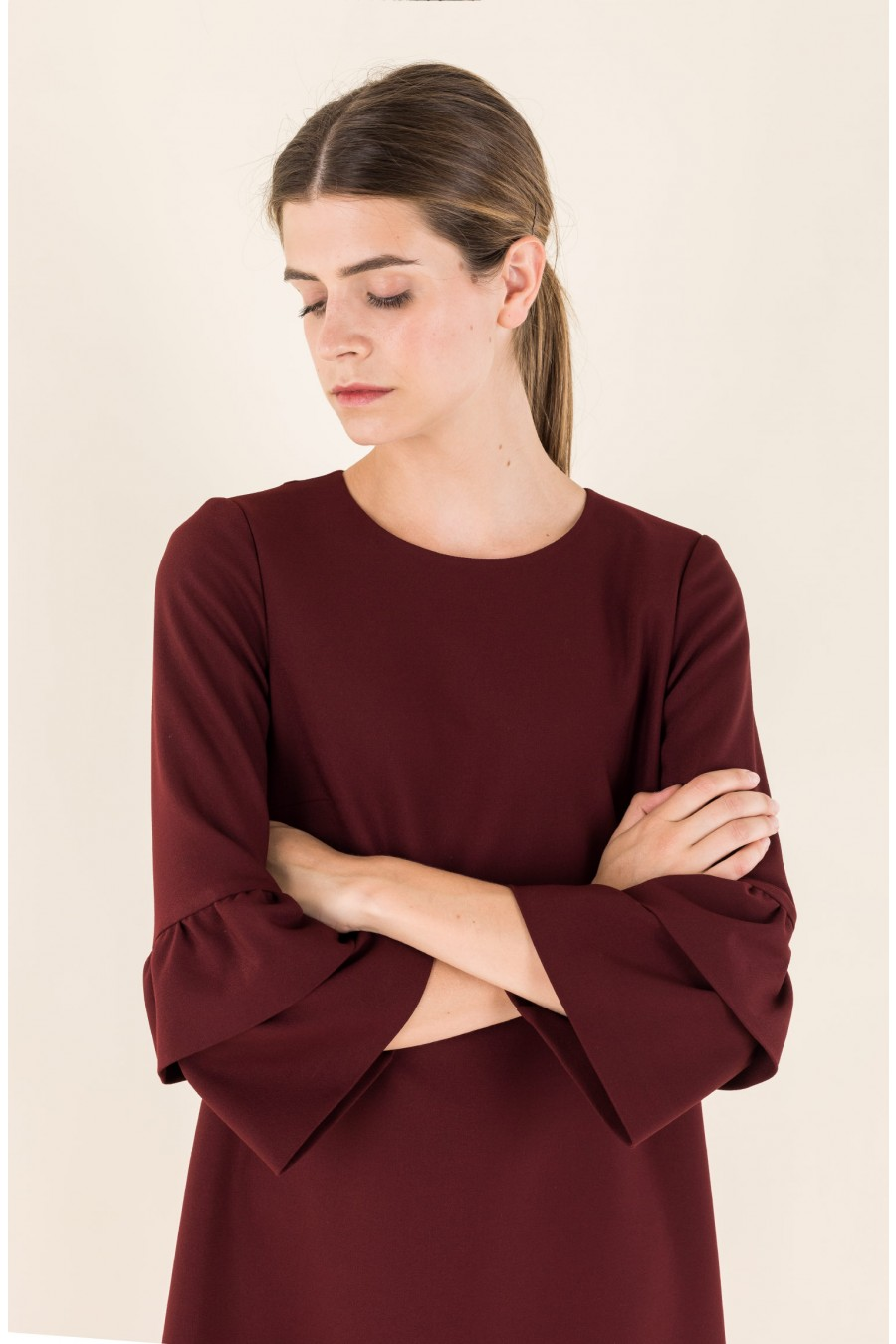 Burgundy dress with ruffles on the sleeves