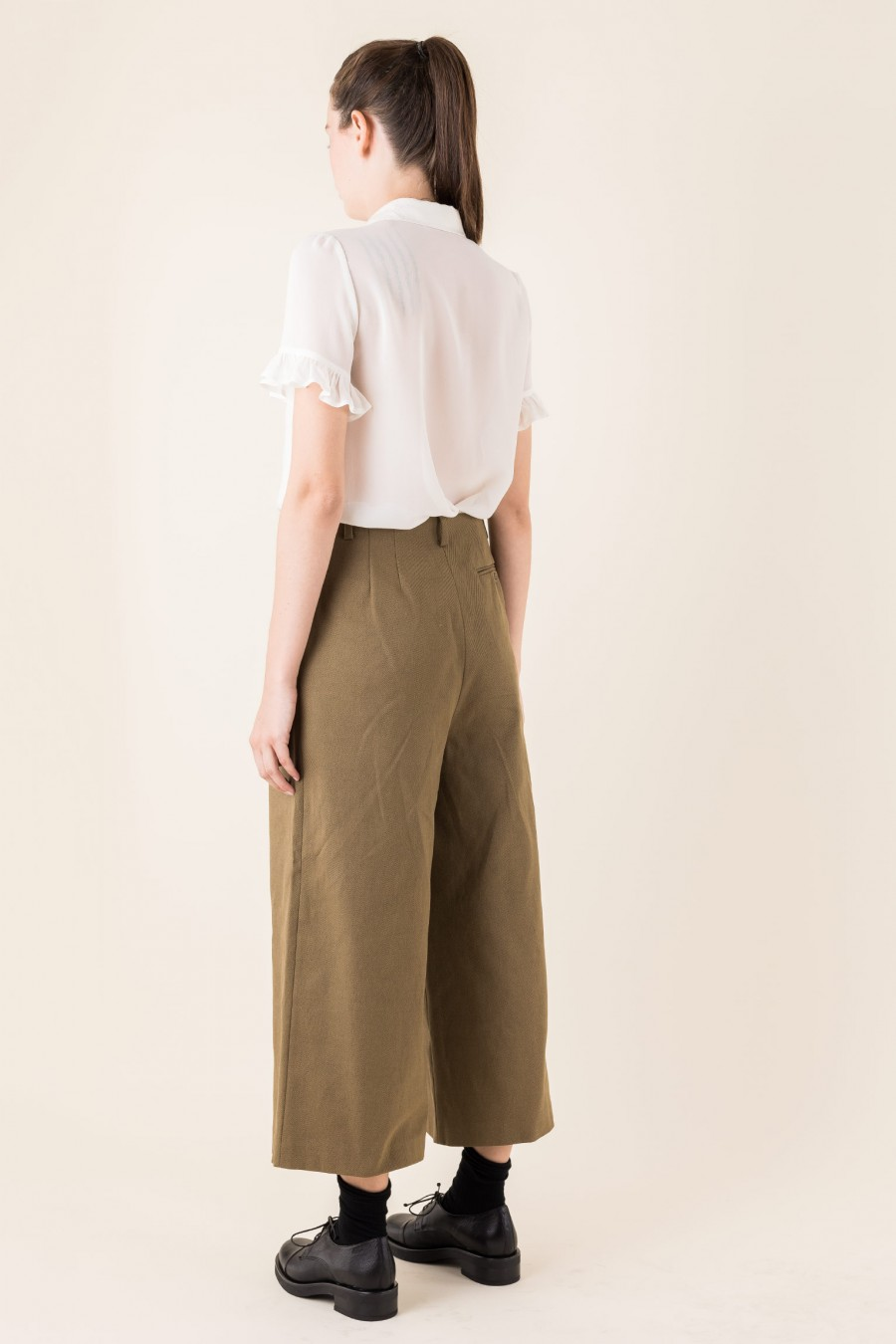 Wide brown trousers