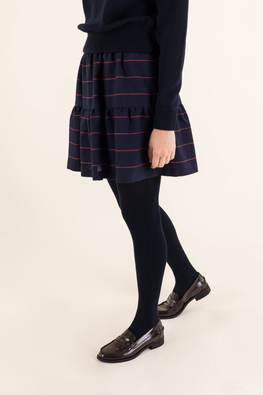 Blue skirt with red stripes