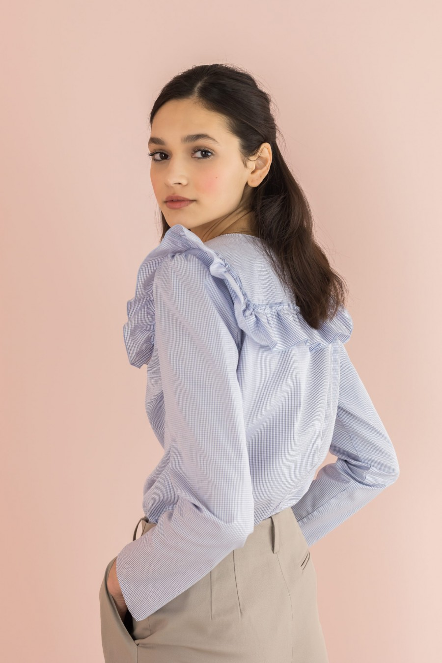 white and light blue shirt with ruffles