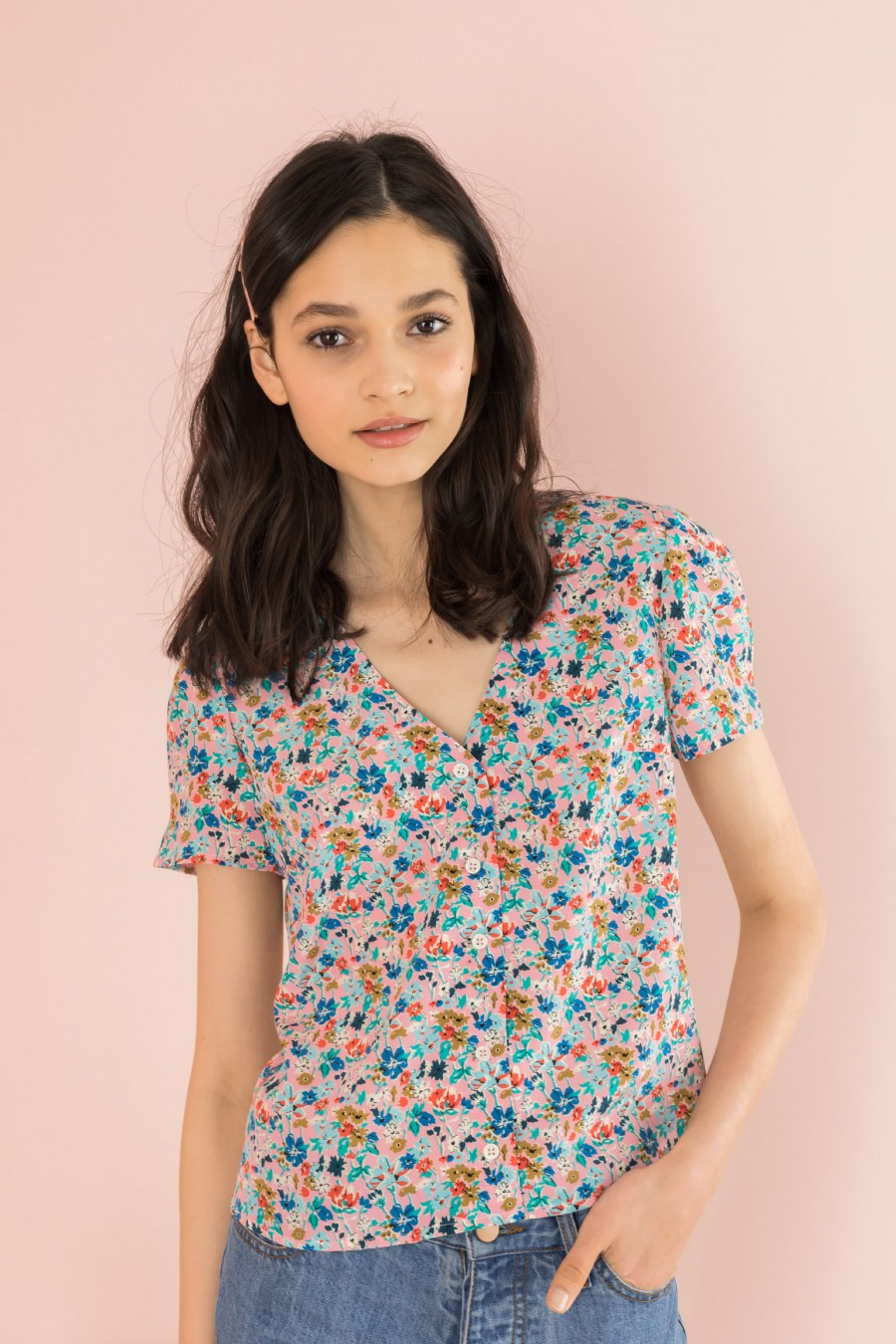 silk shirt with pattern on pink background and short sleeves