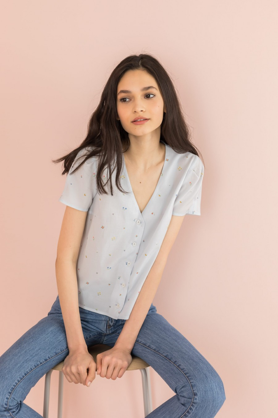 light blue shirt with V-neck