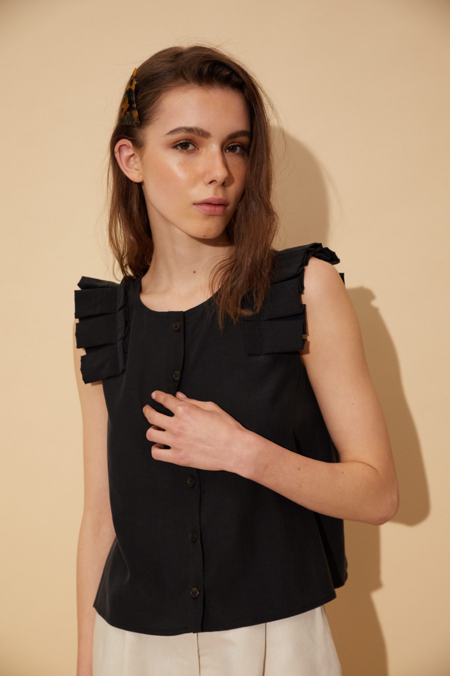 black blouse with origami cap sleeves