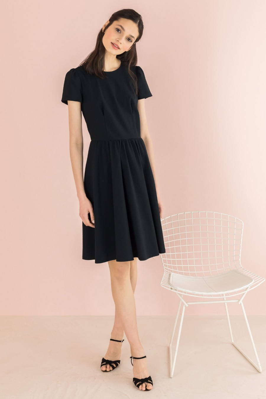 black dress with gathered skirt and short sleeves