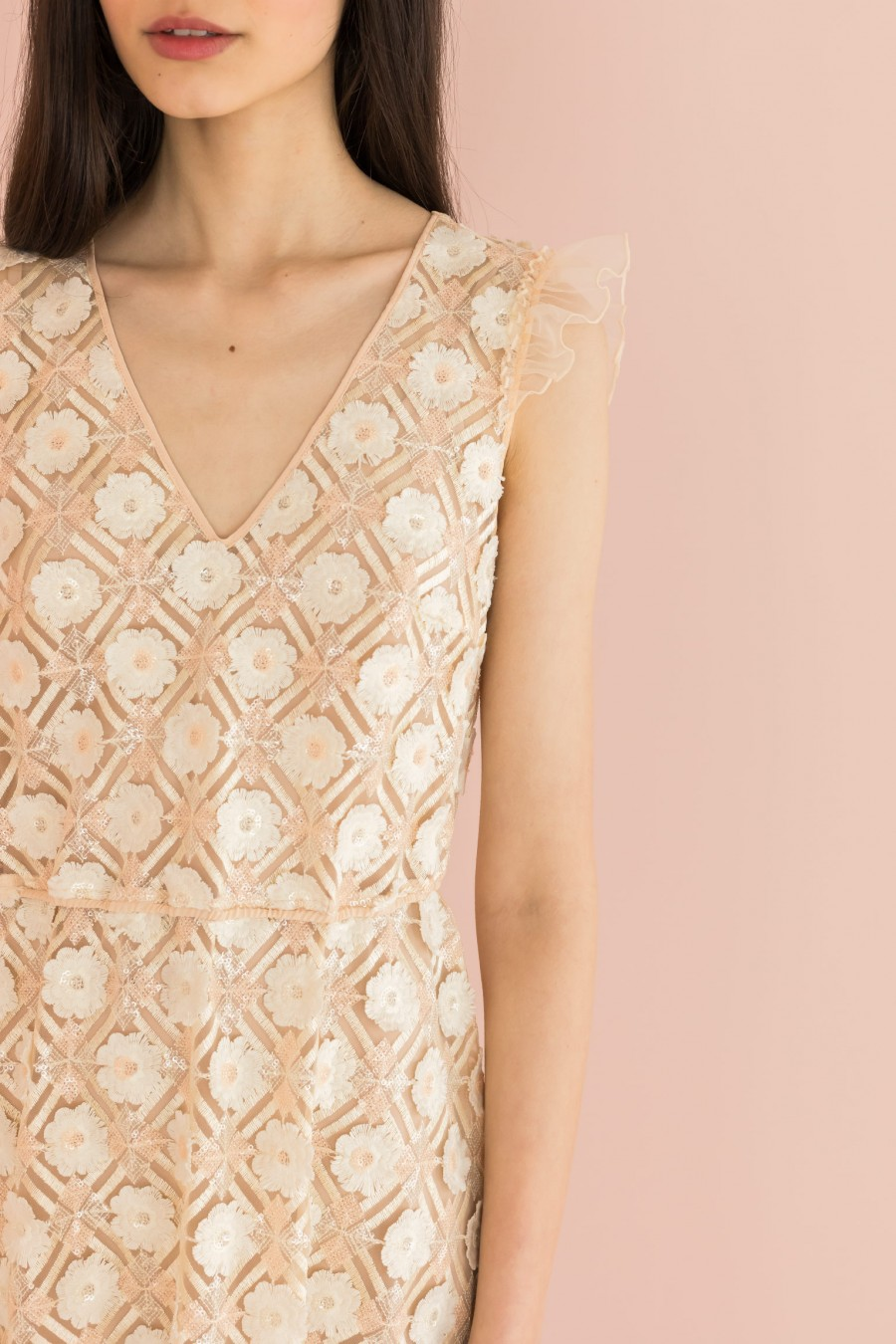 embroidered cream dress with ruffle on the shoulders