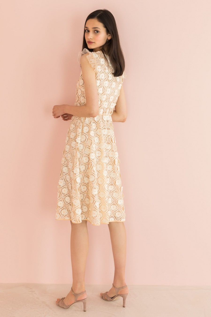 cream dress with ruffle on the shoulders