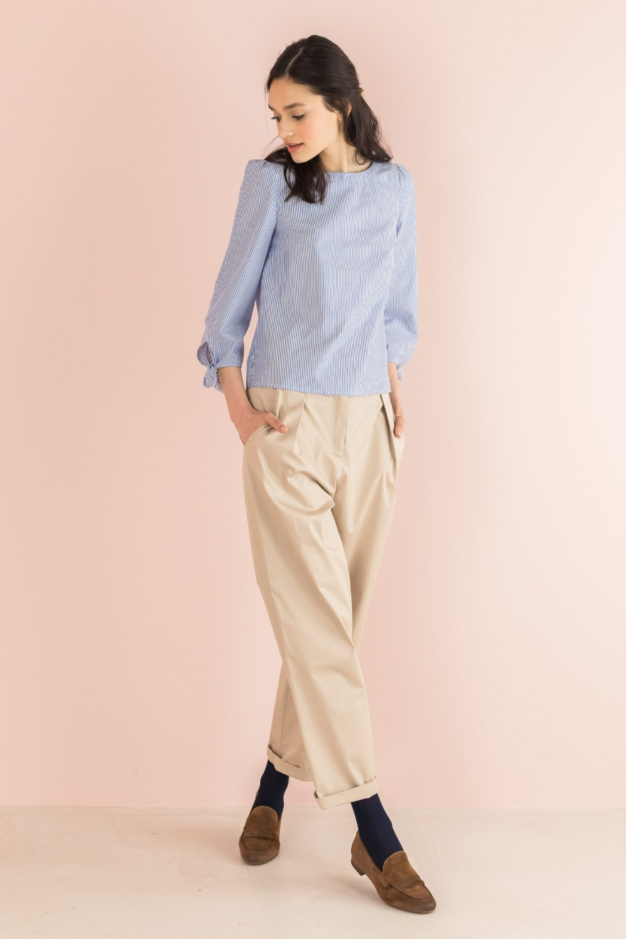 beige trousers in light fabric