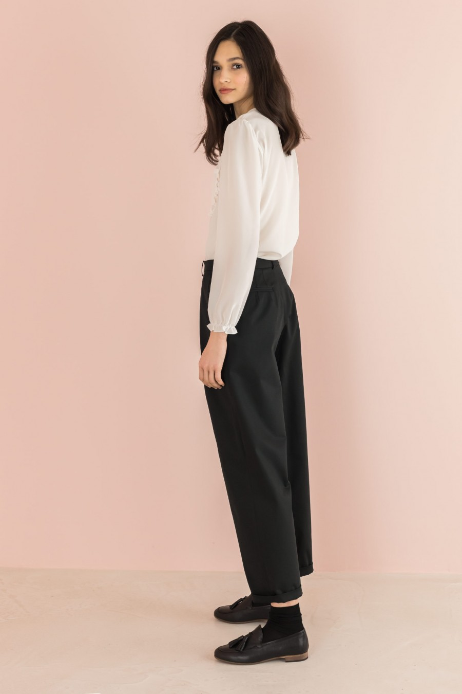 black trousers with ruffles on the pockets