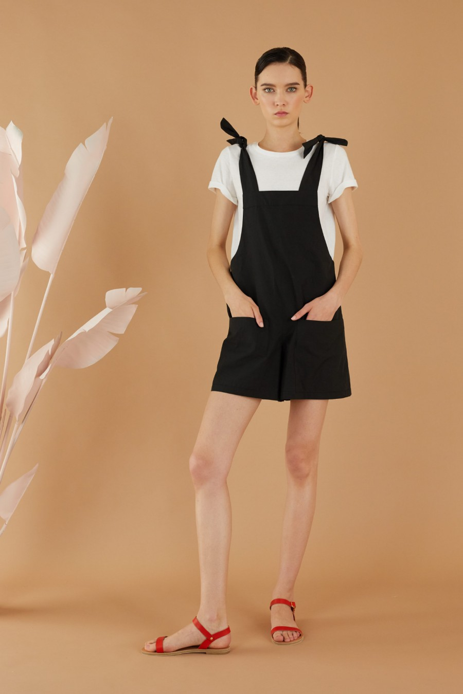 Black romper with frontal pockets
