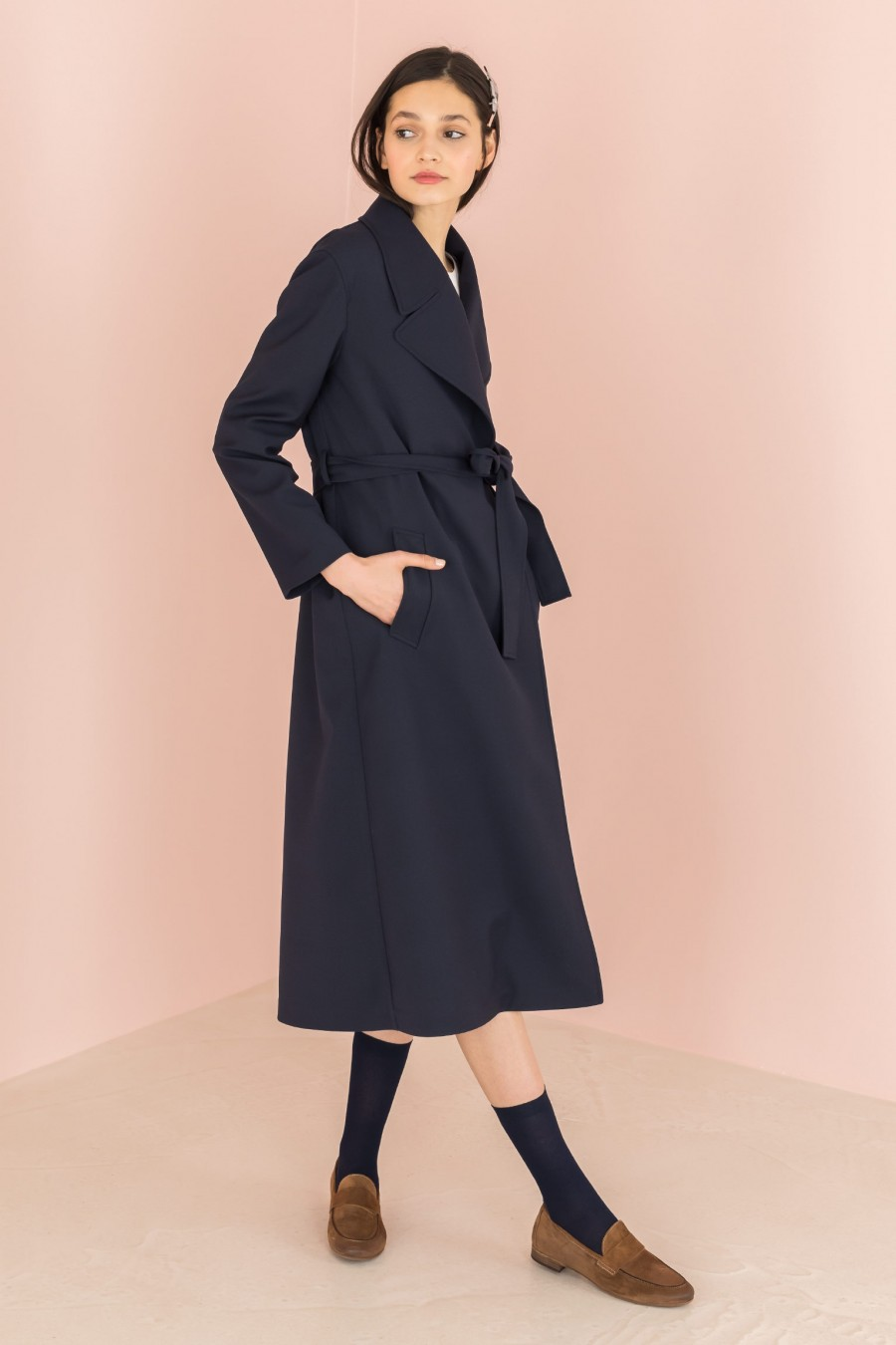 long blue trench with fluid fabric
