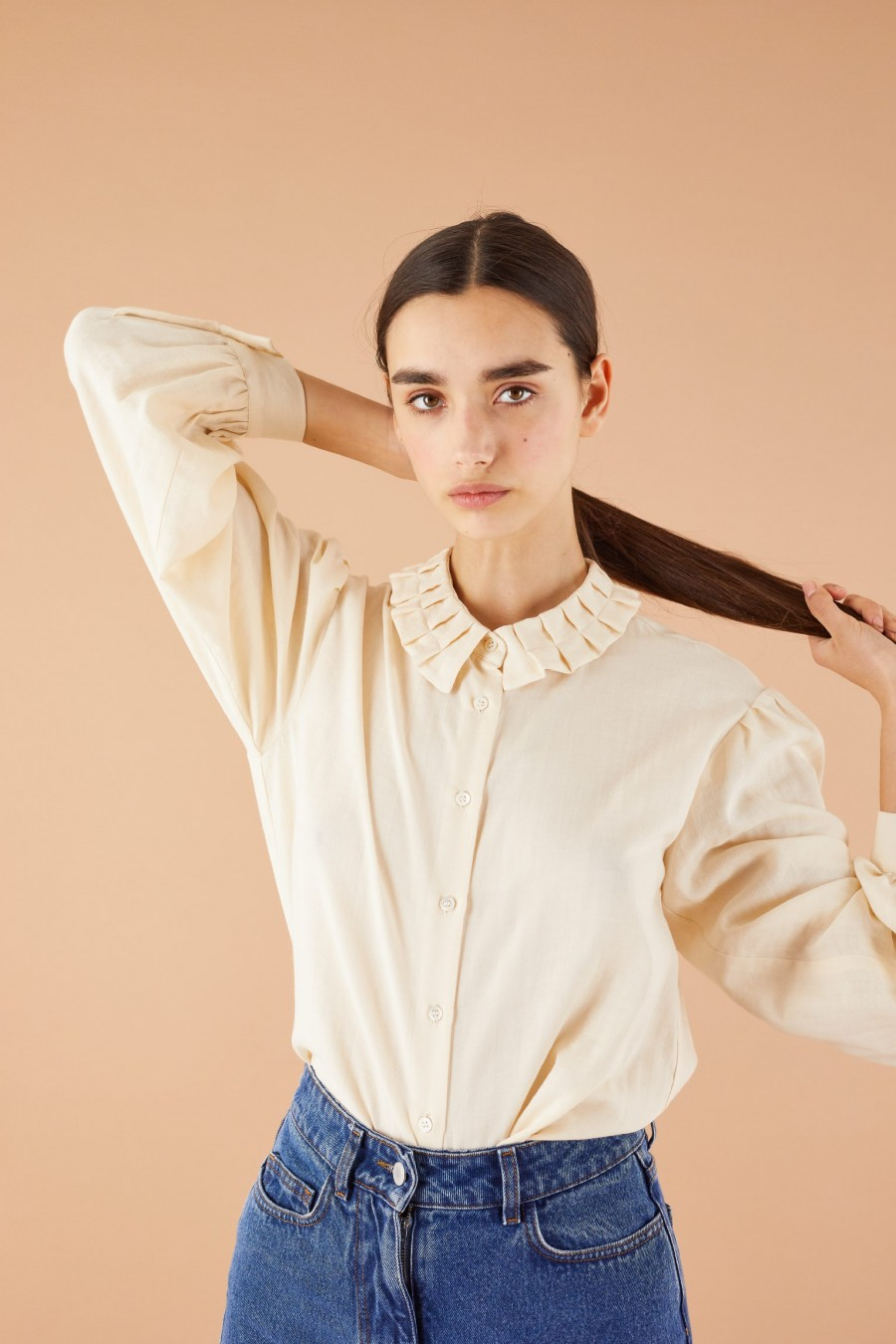 cream shirt with pleated collar