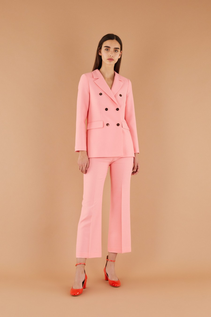 bright pink suit with trumpet trousers