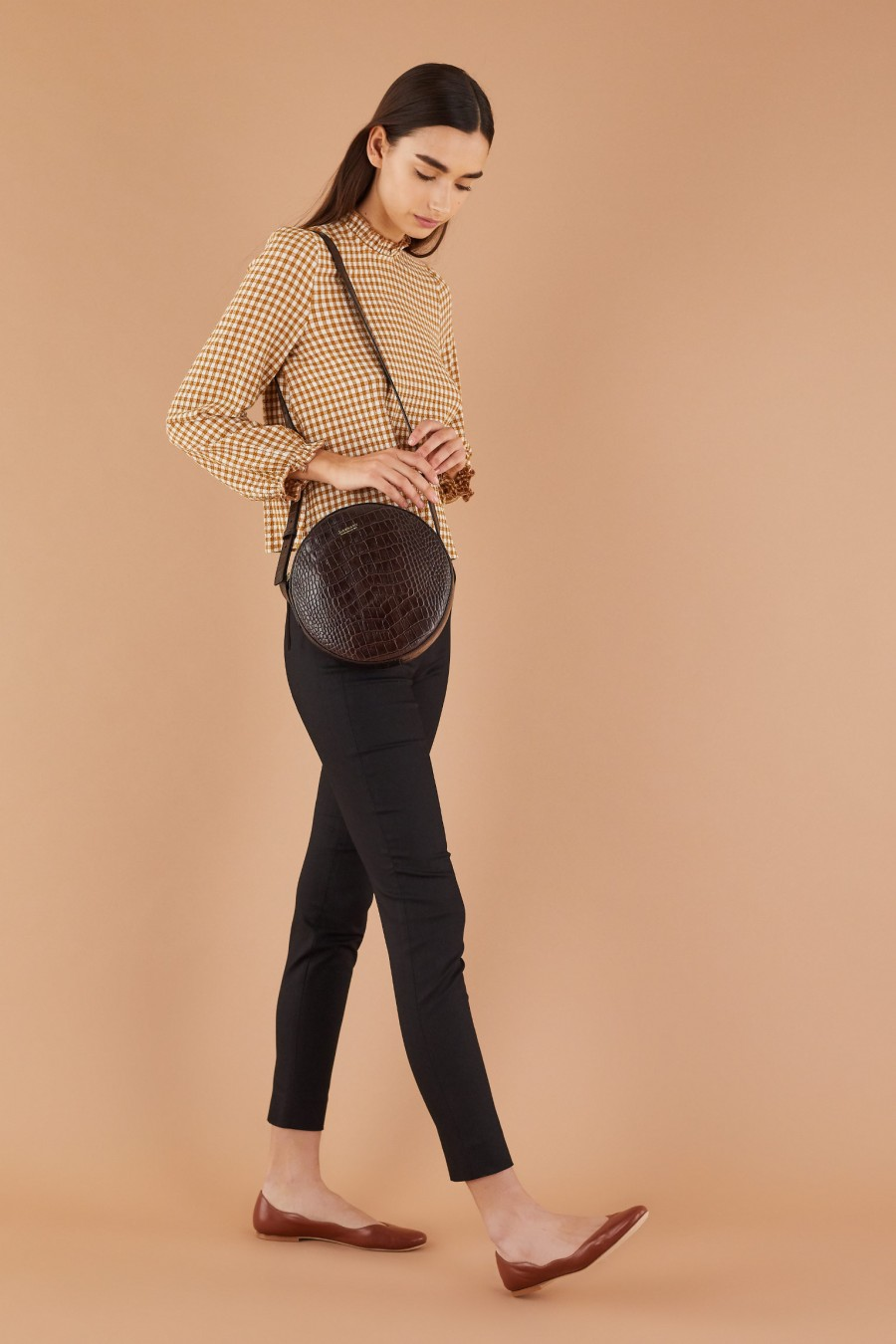 casual style with black fitted trousers