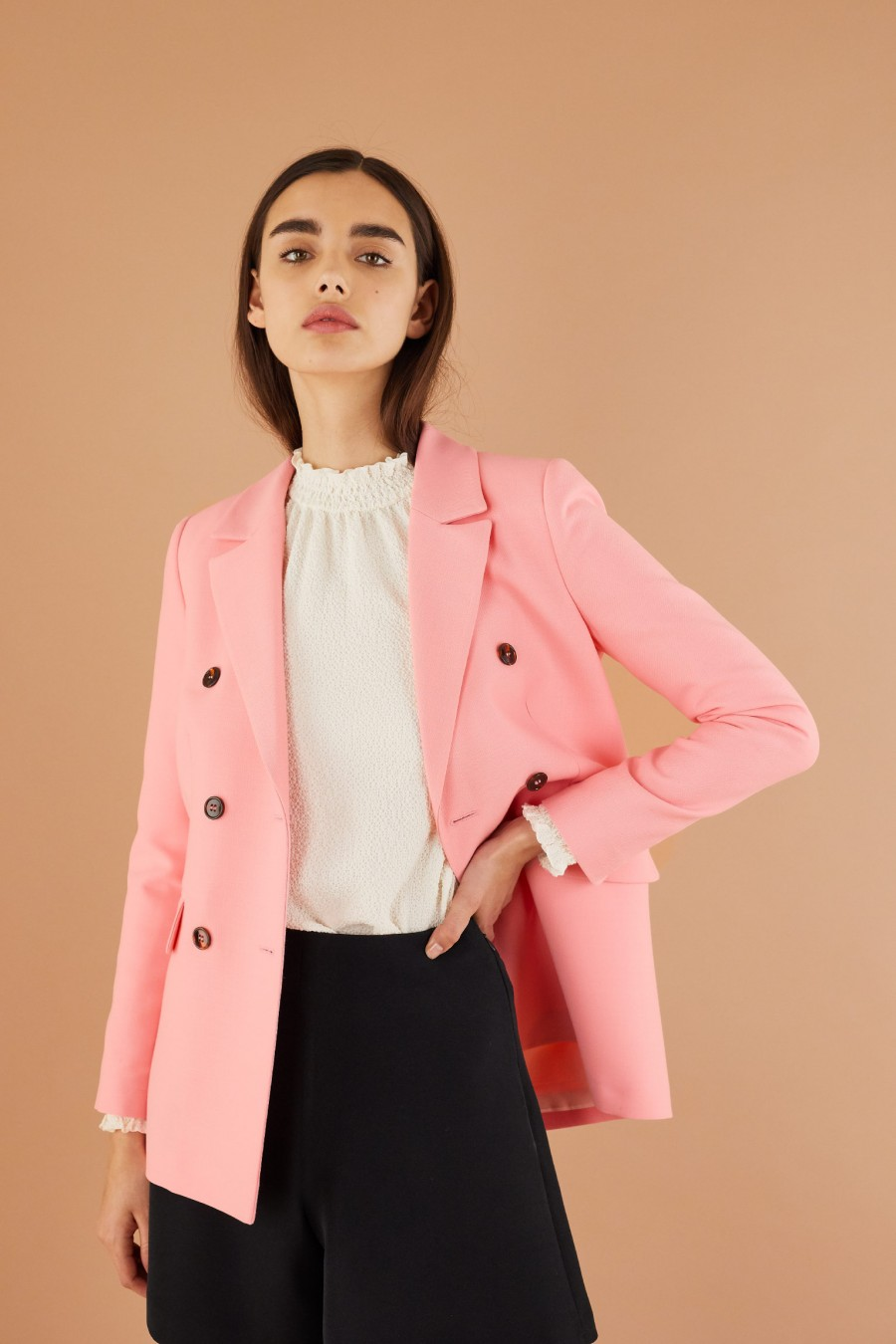 pink jacket with black buttons