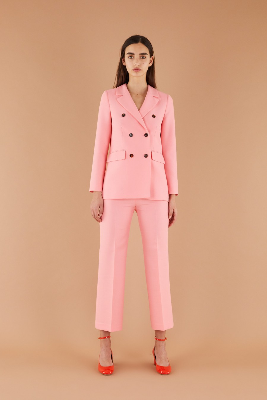 stylish bright pink suit