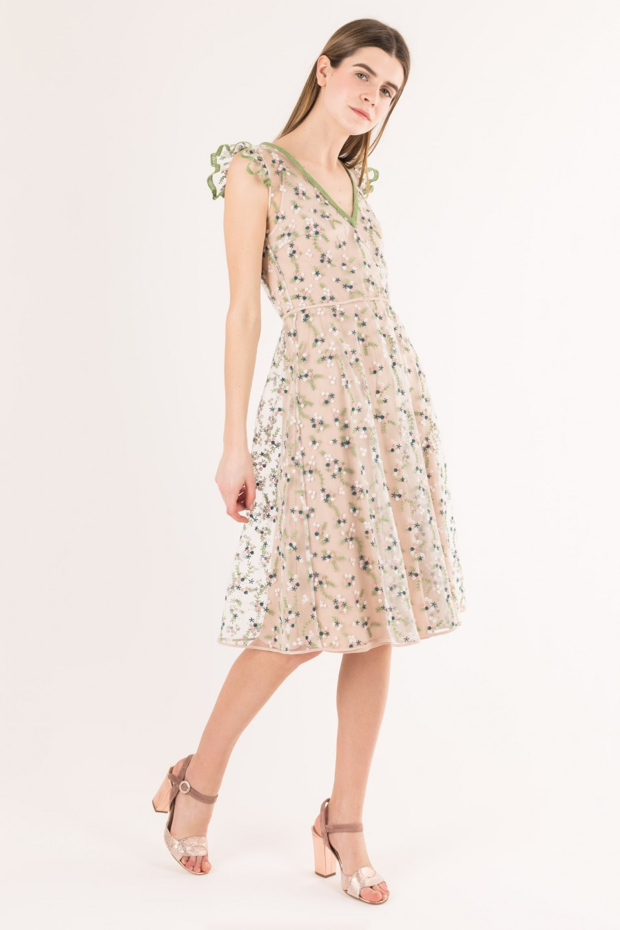 Dress in embroidered tulle with ruffles