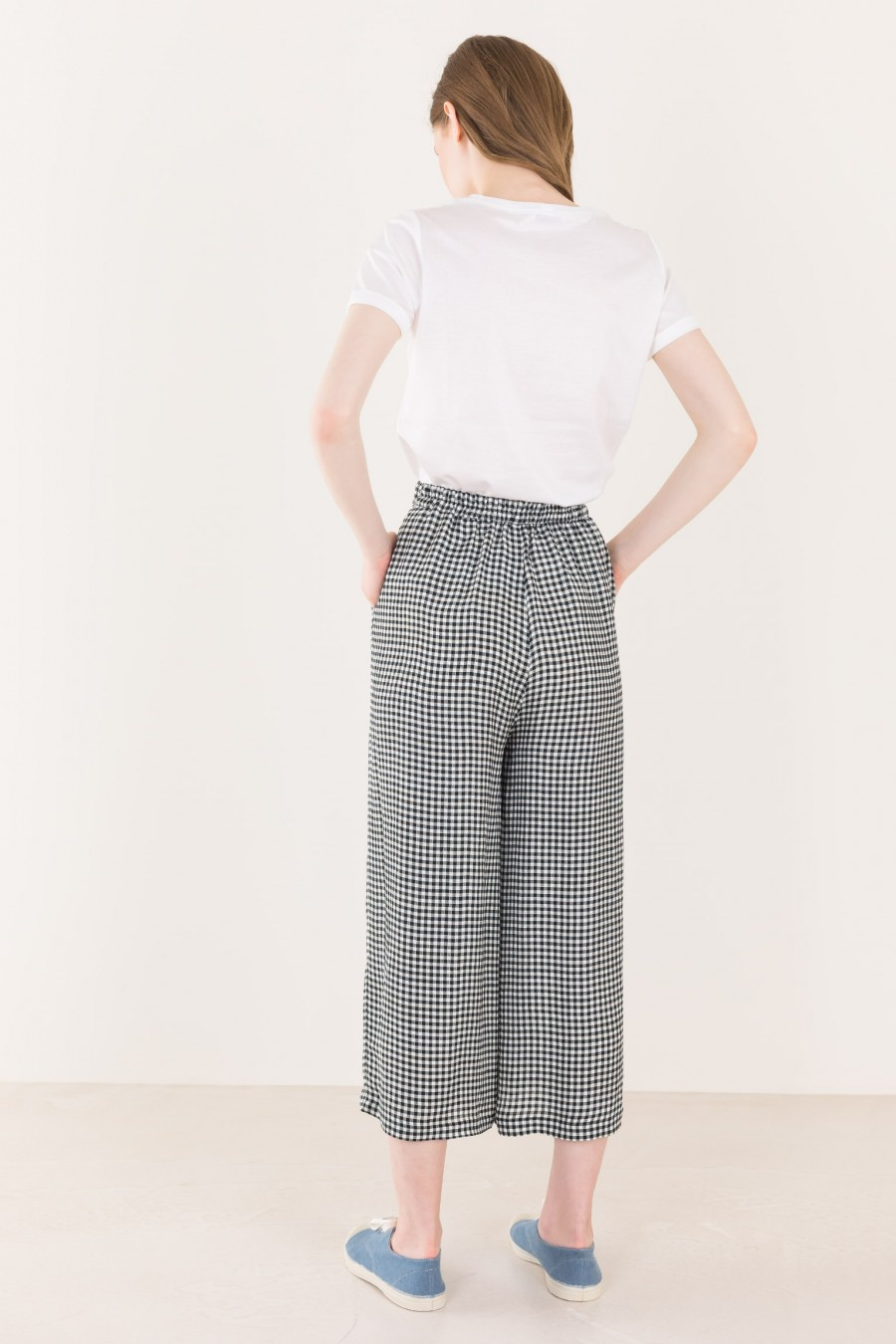 Black and white checked trousers