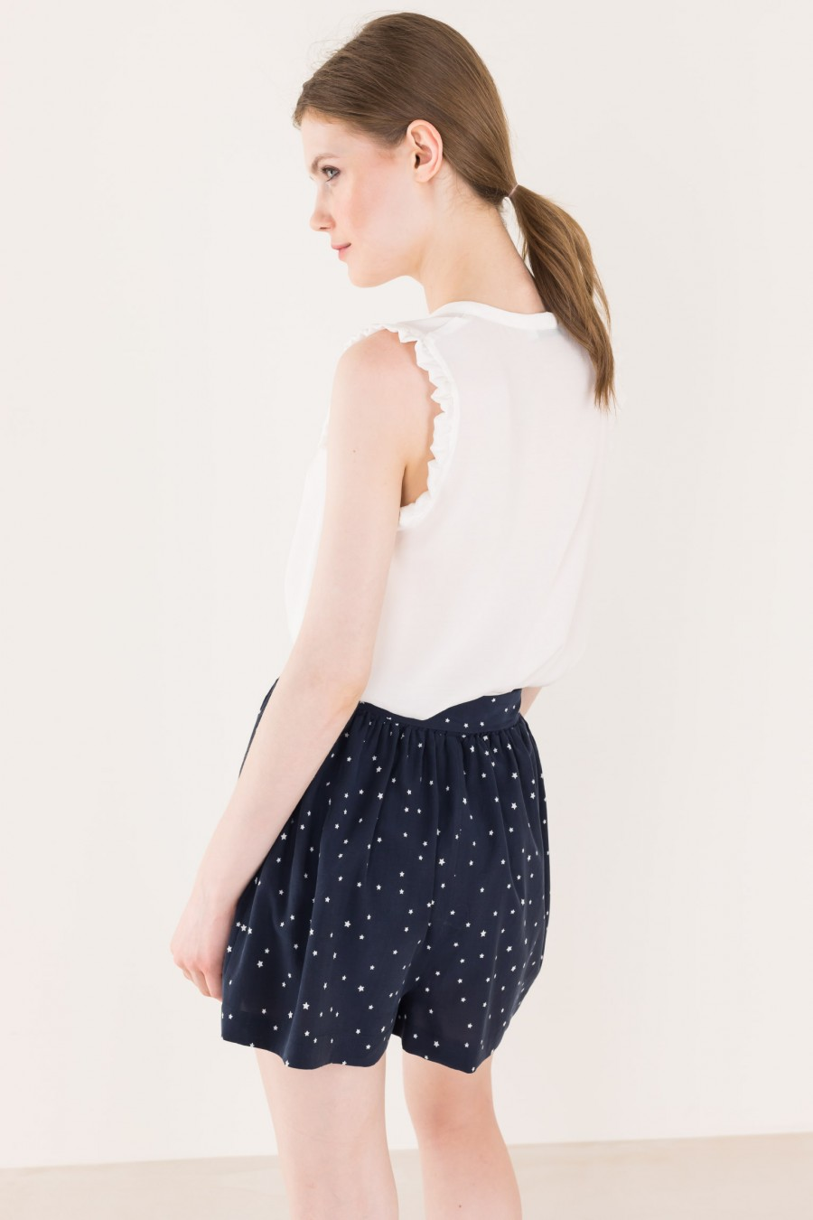 Blue mini skirt-pants with strars pattern