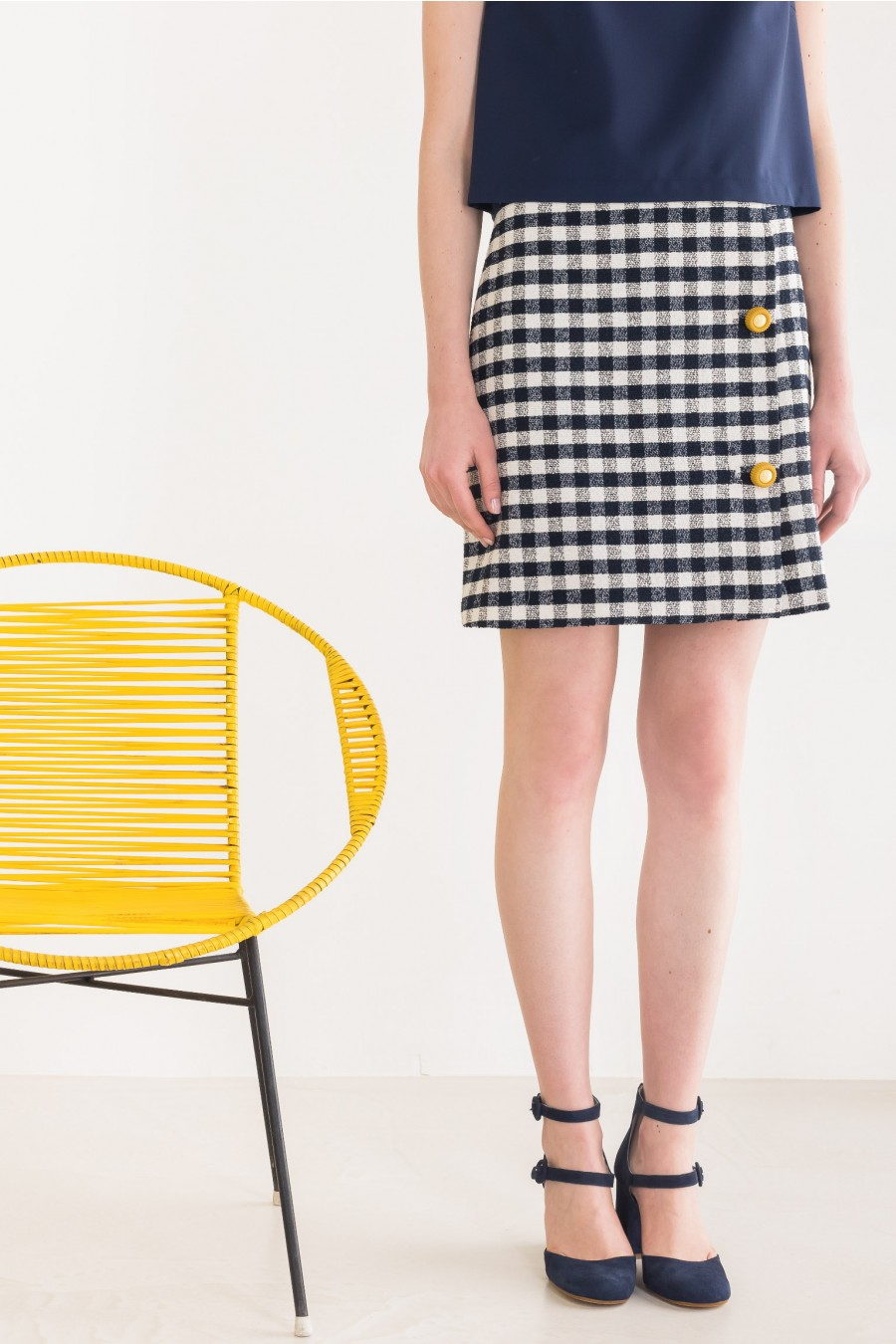 Blue skirt with yellow buttons