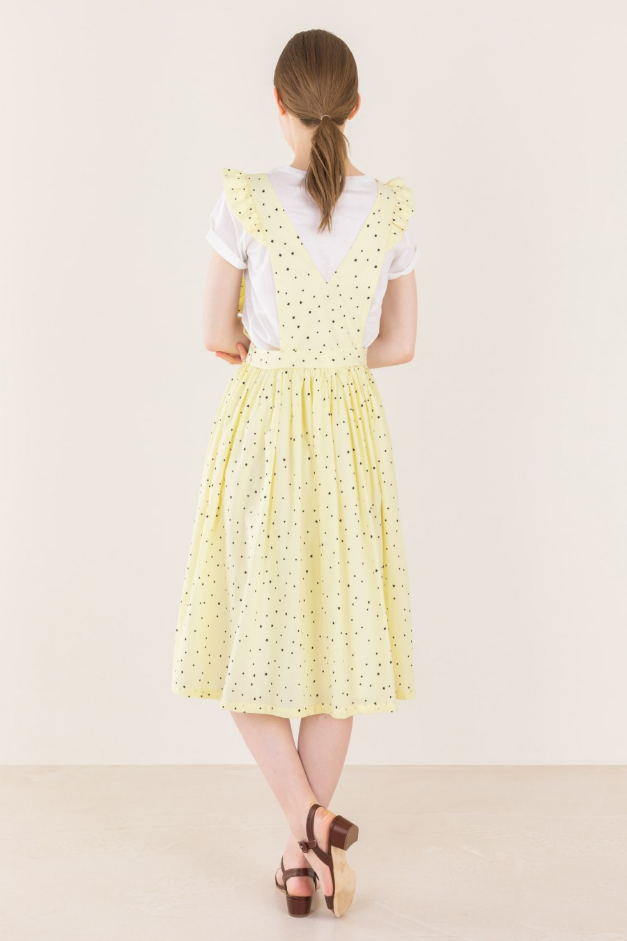 Pale yellow dress with starry print