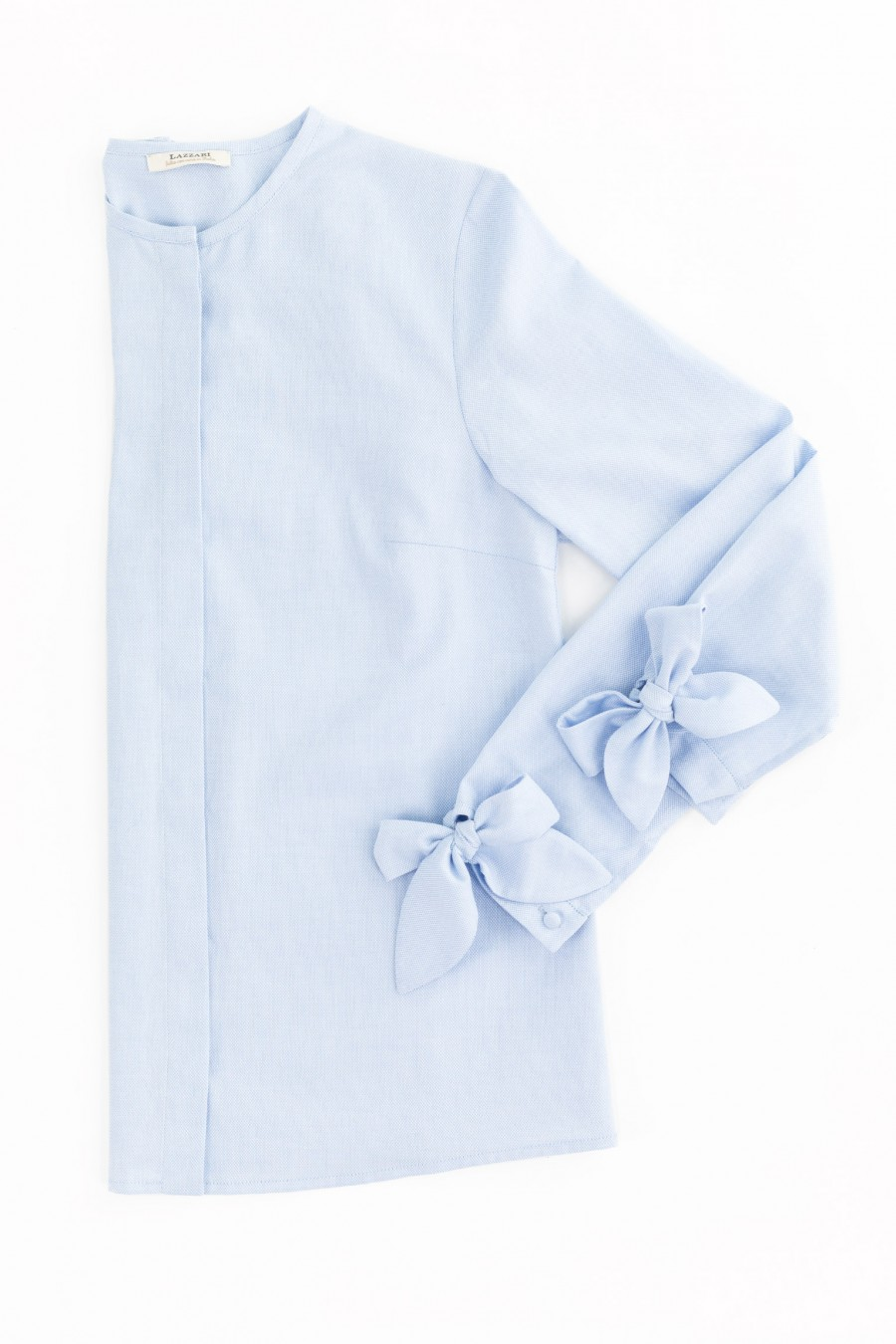 Shirt with bows on the cuffs