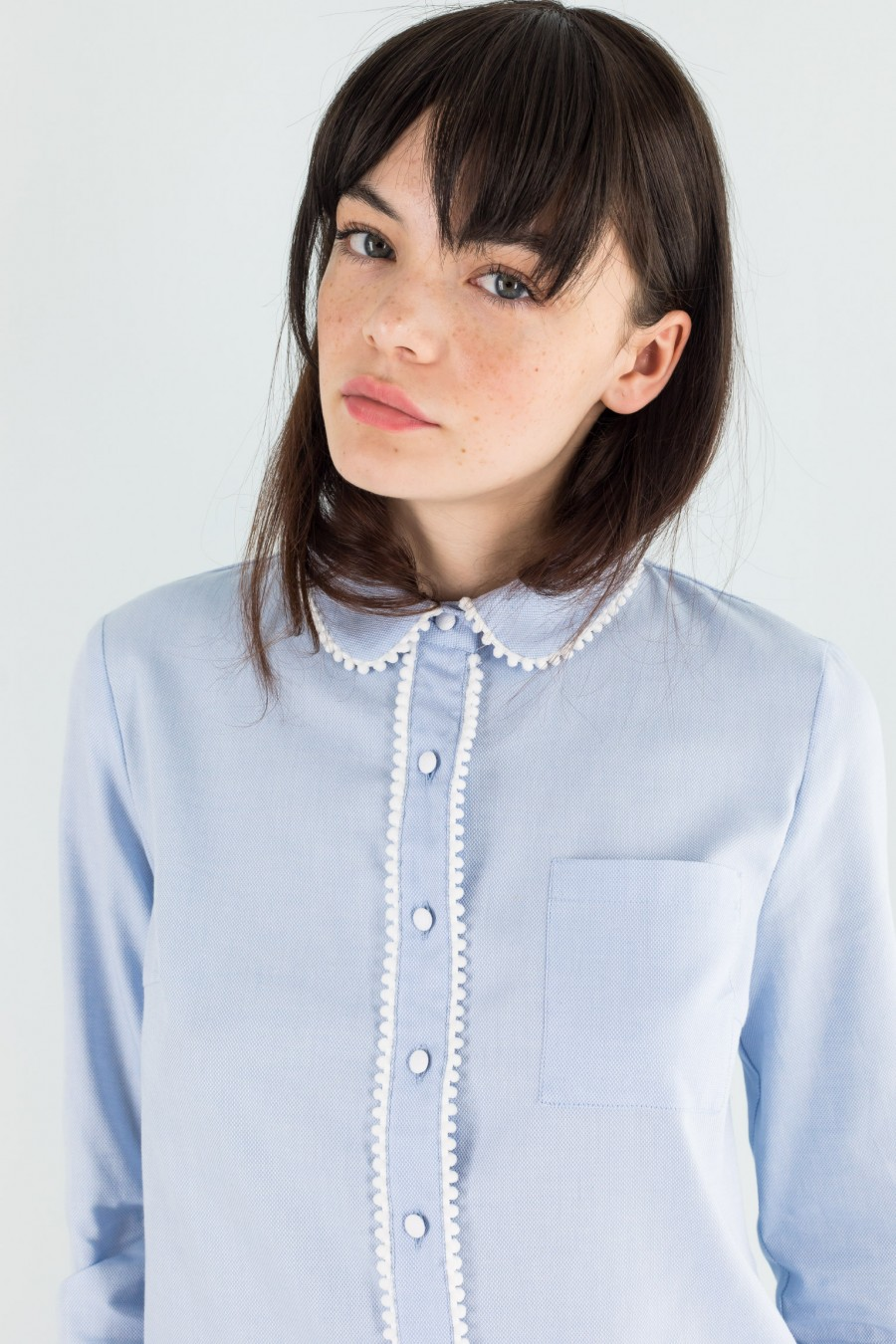 Light blue shirt with white pompons
