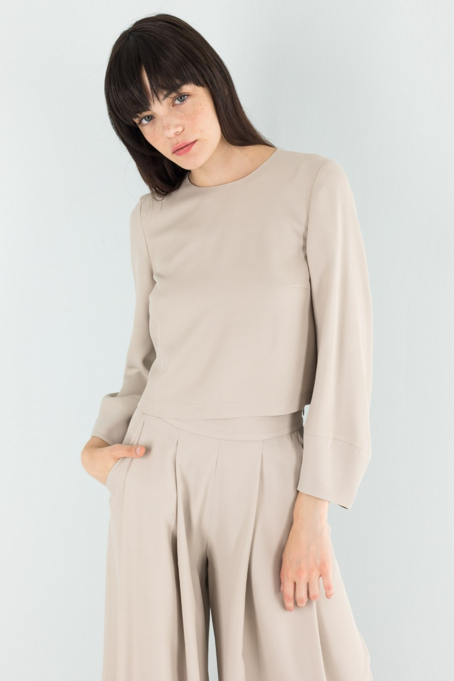 Beige top with egg-shaped sleeves