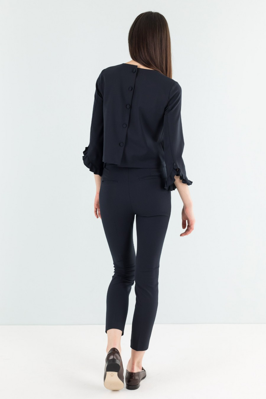 Top with buttons on the back