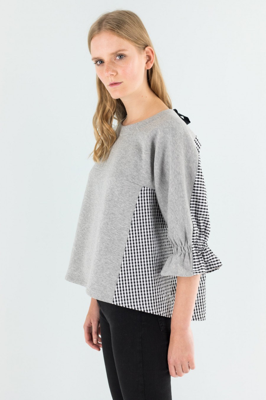 Sweater with black and white inserts
