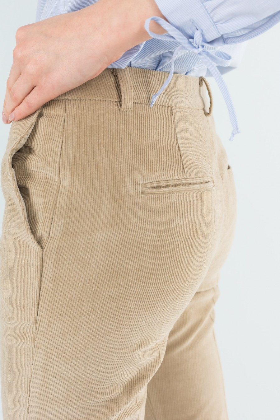 Slim fitting beige trousers