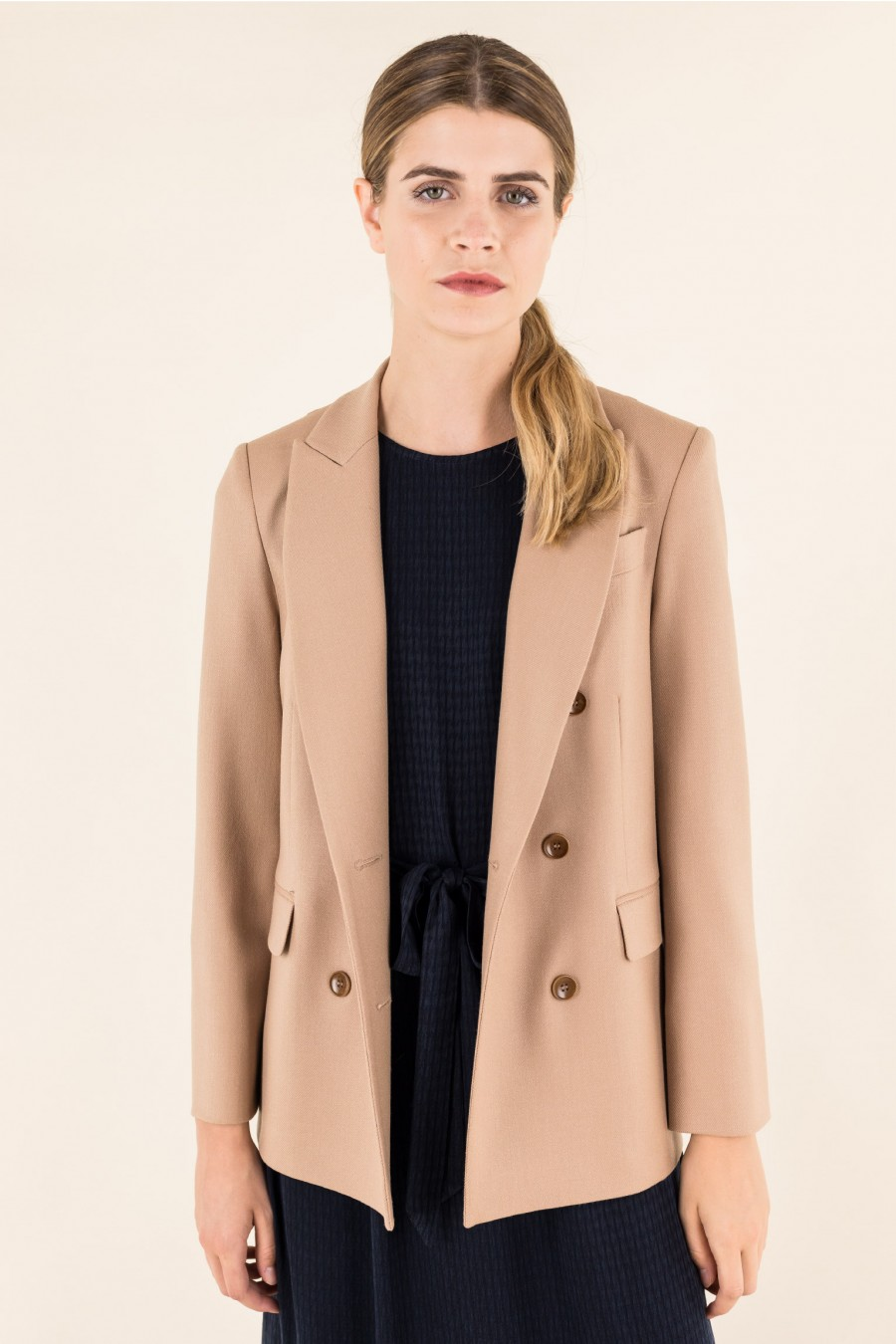 Double-breasted beige jacket