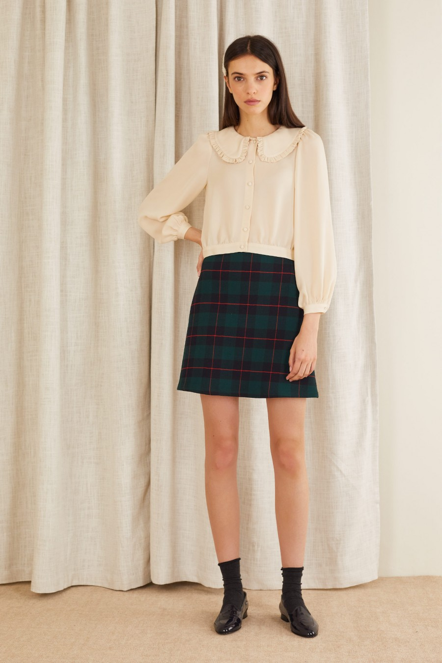 cropped shirt with high waisted skirt