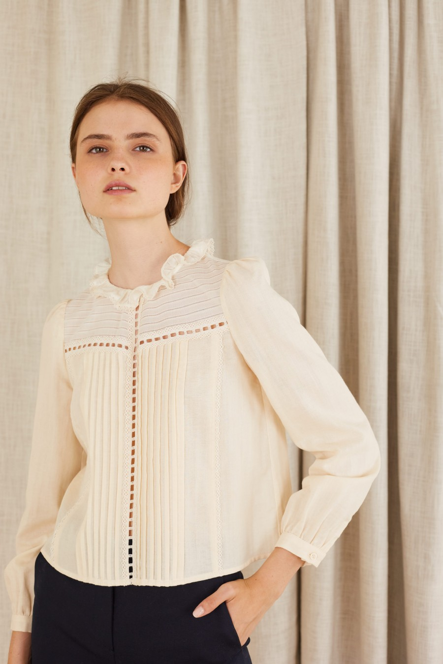 Blouse with lace inserts