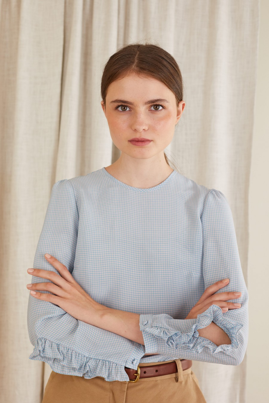 checked blouse with ruffled slits on the sleeves