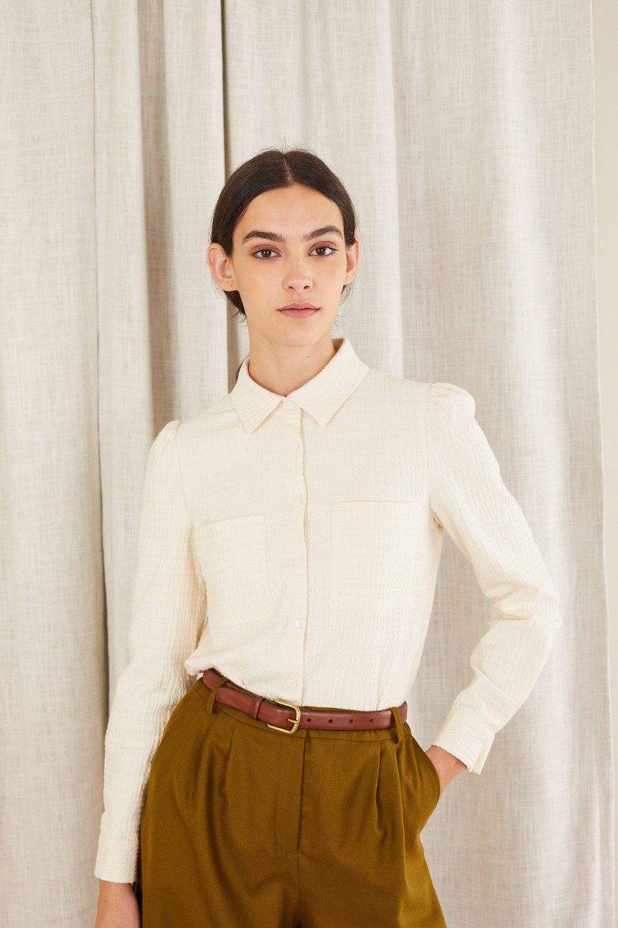 Embossed blouse with enameled snap button