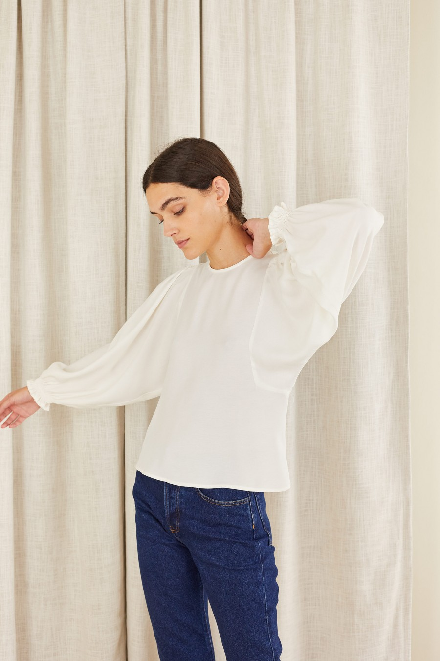 white blouse with gathered cuffs