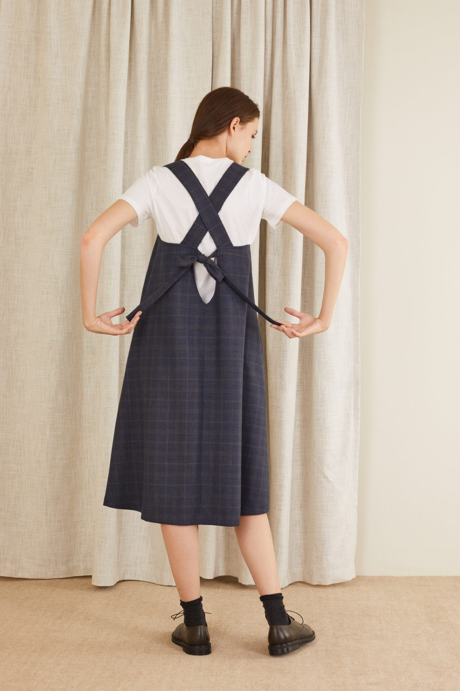 pinafore dress with a bow on the back