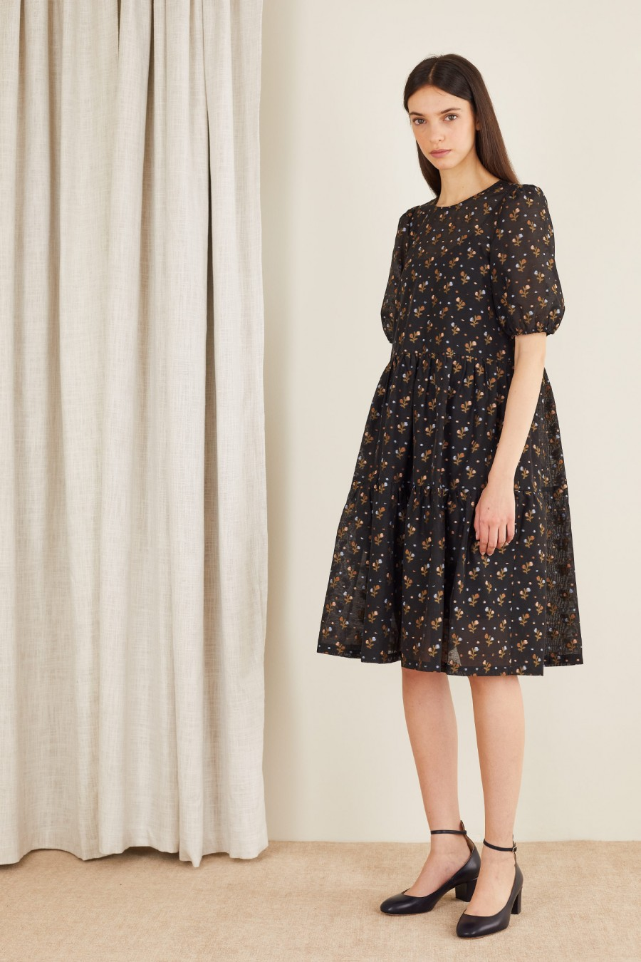 dress with jacquard flowers on a black background
