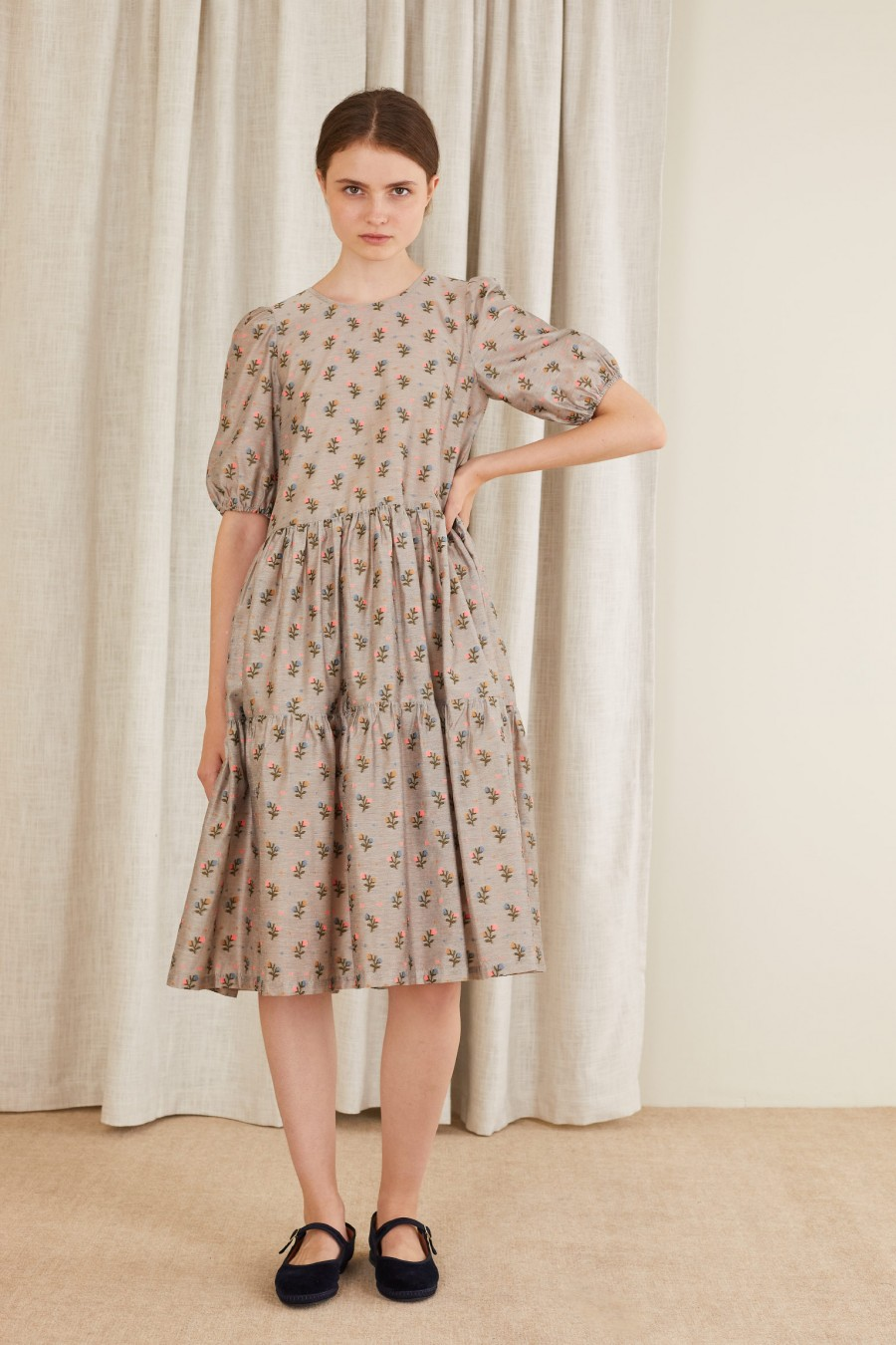 dres with jacquard flowers on a grey background