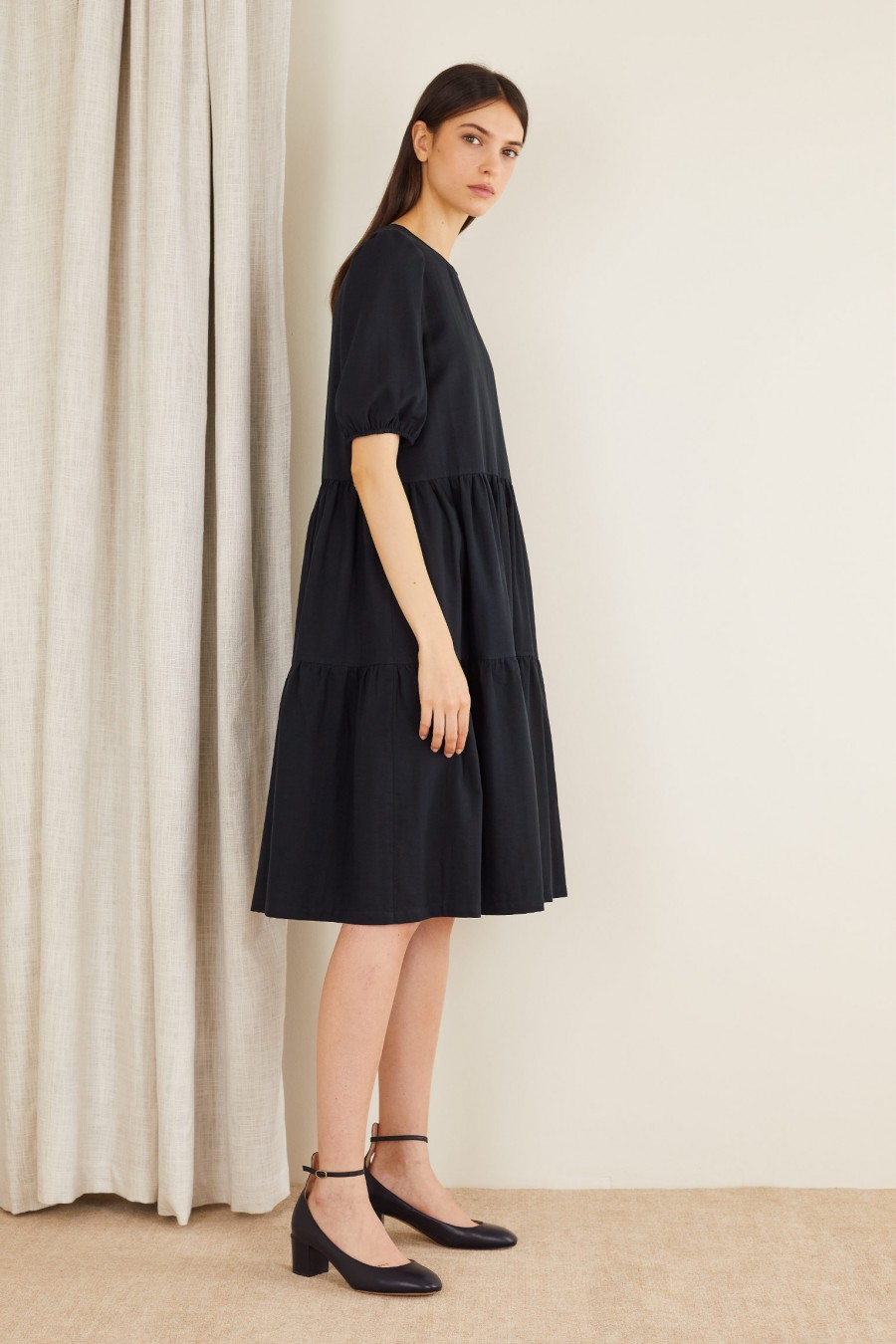 black dress with wide sleeves