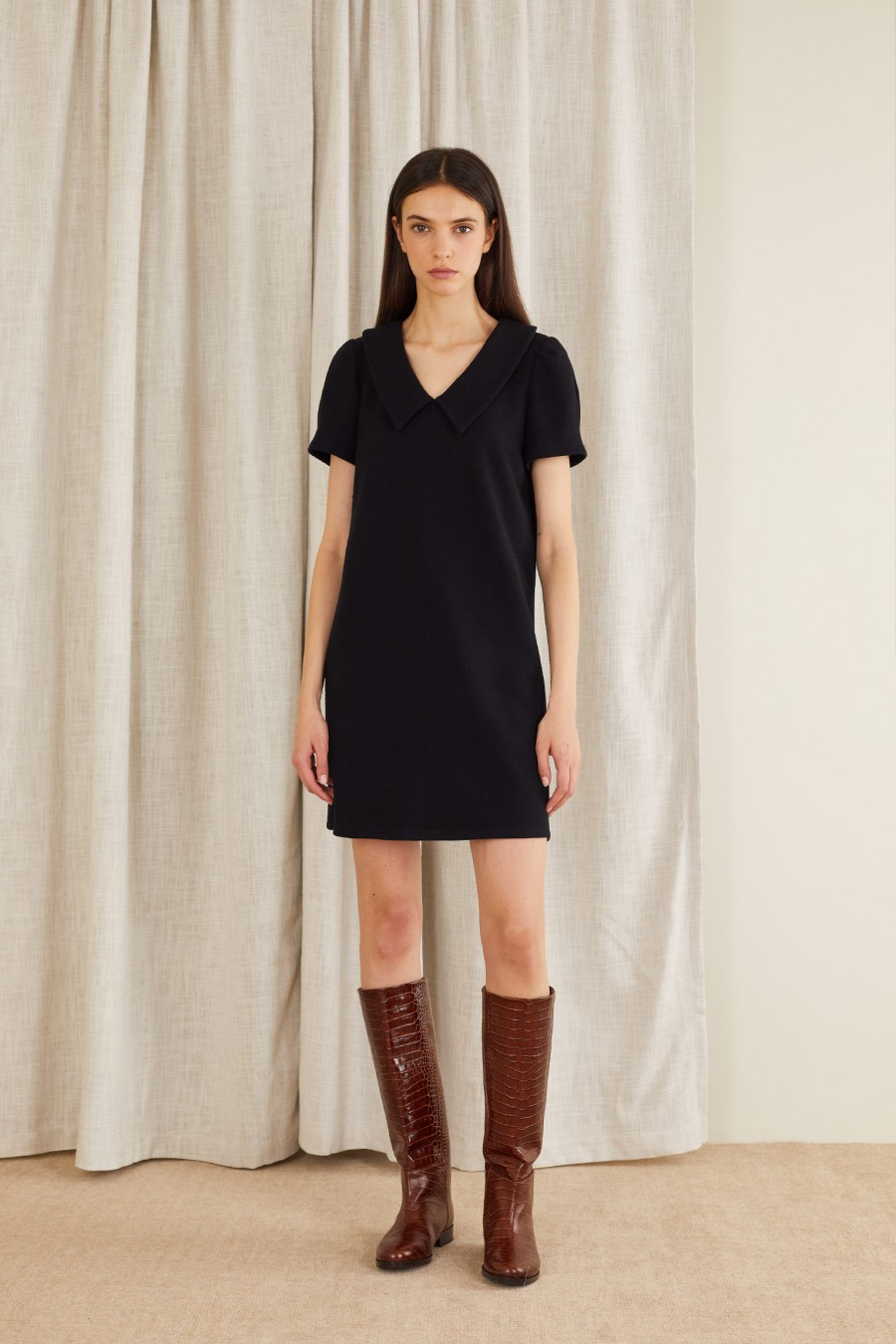 black dress with sculptural sleeves