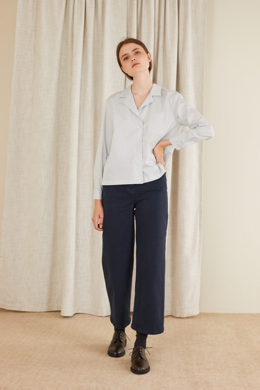 casual look with shirt and blue trousers