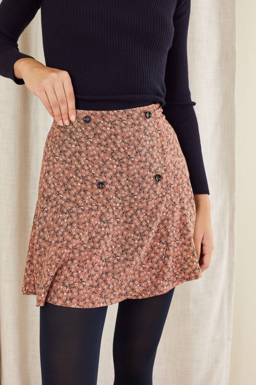 ancient pink mini skirt with black buttons