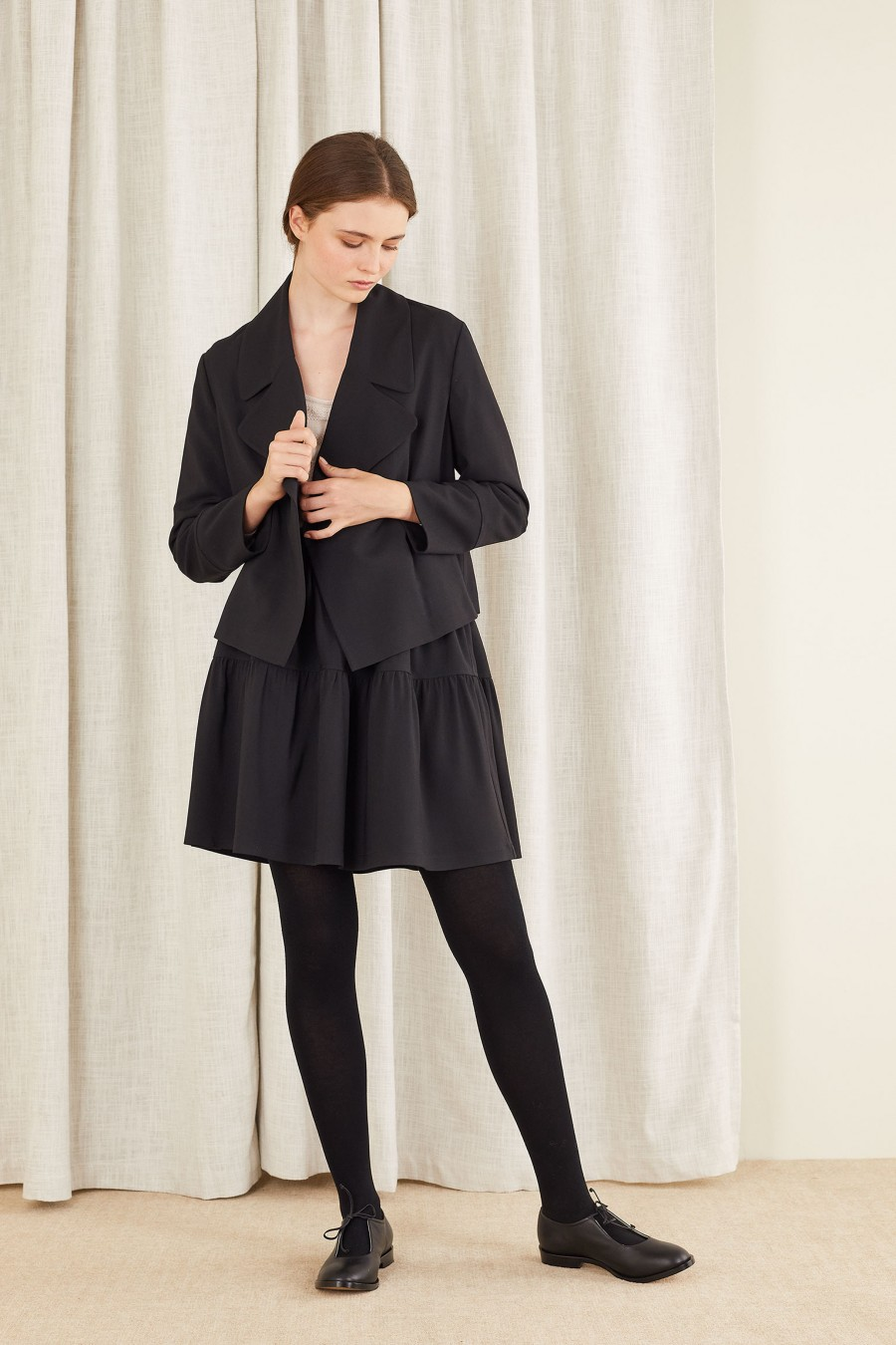 fluid jacket with black tiered skirt
