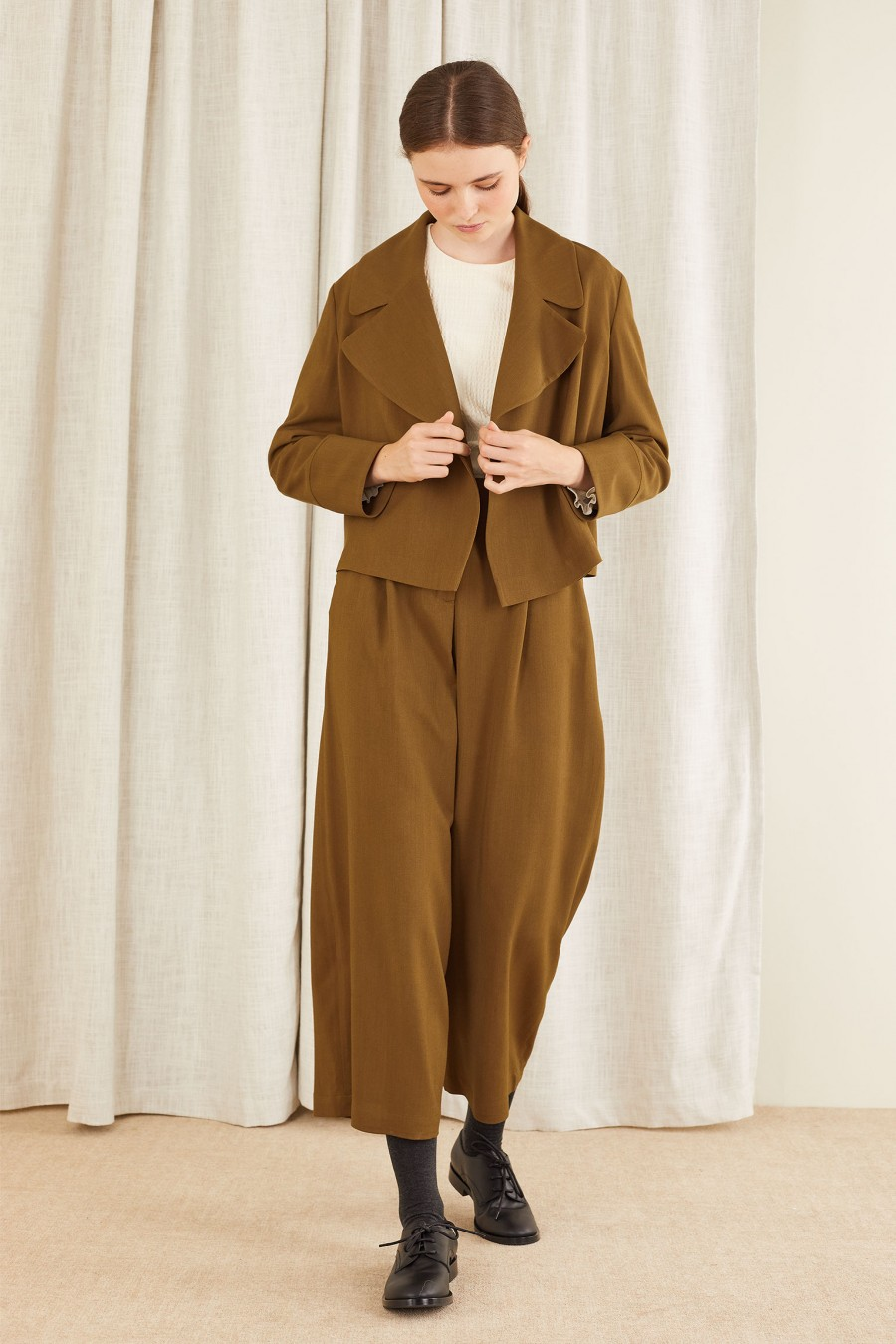 matching brown jacket and trousers