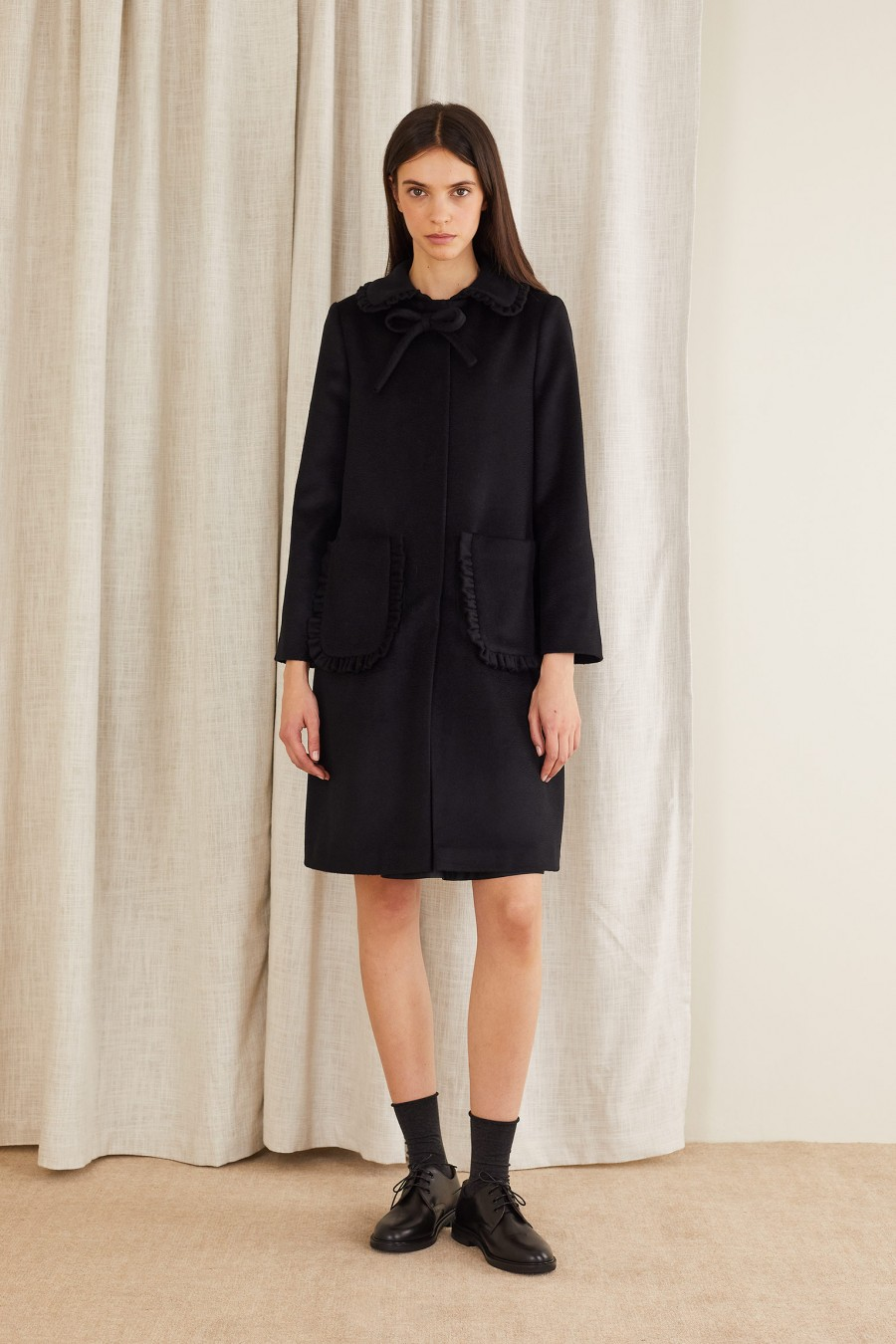 Cashmere coat with collar bow and ruffles