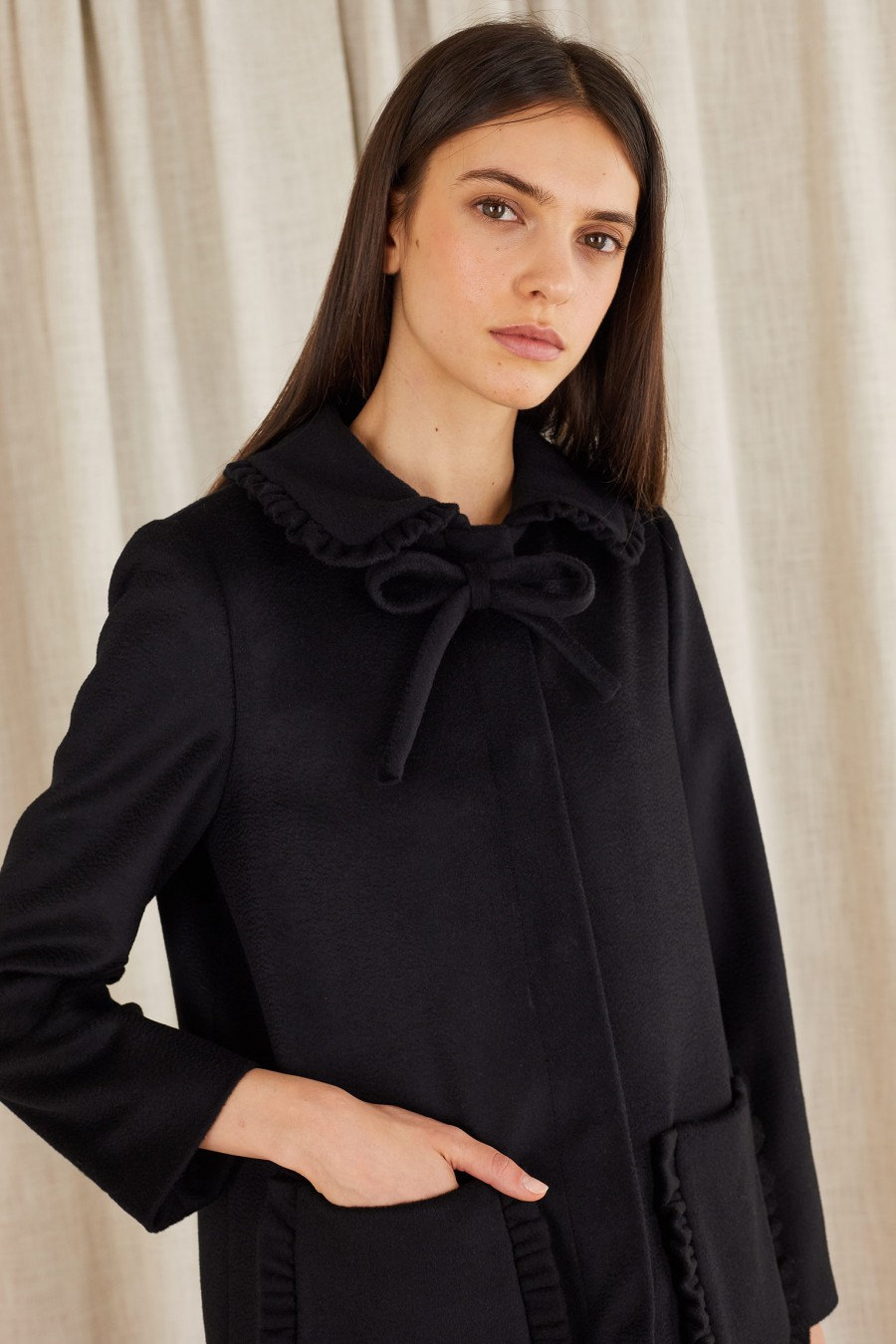 black coat with collar bow