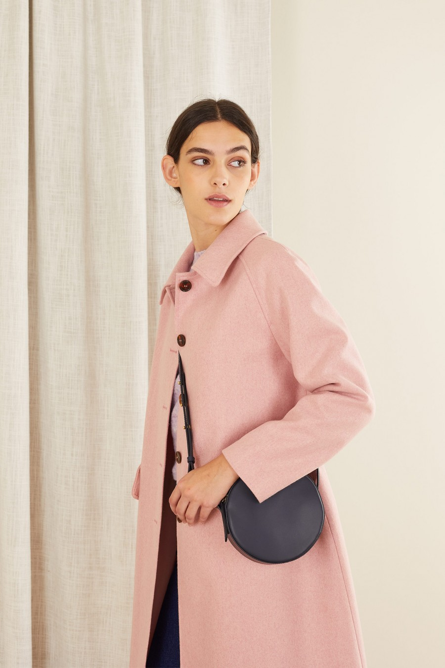 Pink wool coat with black buttons