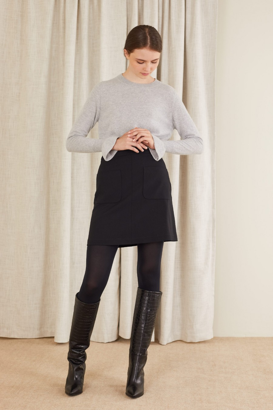 romantic look with skirt and crew-neck jumper
