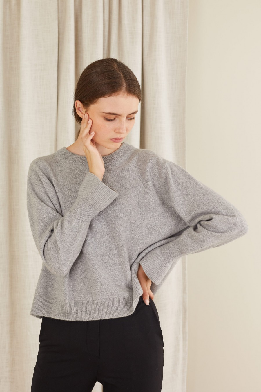 Lamé wool sweater with ruffled cuffs